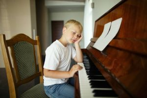 Frustration - Boy Playing Piano